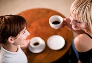 Two young women enjoying a coffee break