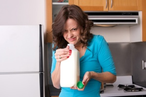 woman-smelling-milk